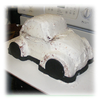 Crumb coating our Volkswagen Bug Cake